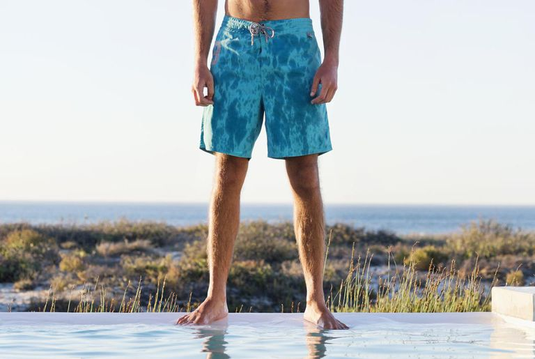 164efd7f78656 Swim trunks. Man standing at the poolside