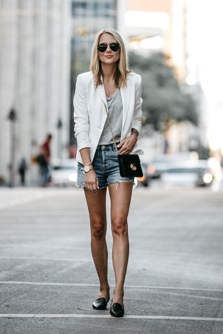 7266abcd5e4 Woman in white blazer and jean shorts. Fashion Jackson