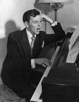 Frank Sinatra singing at a piano
