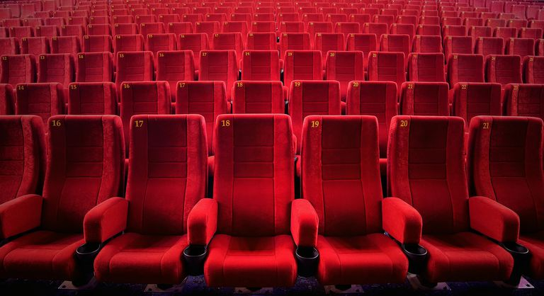 Red Empty Seats At Movie Theater