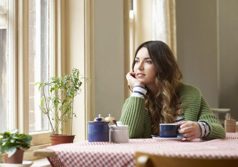 Woman sitting in cafe with drink