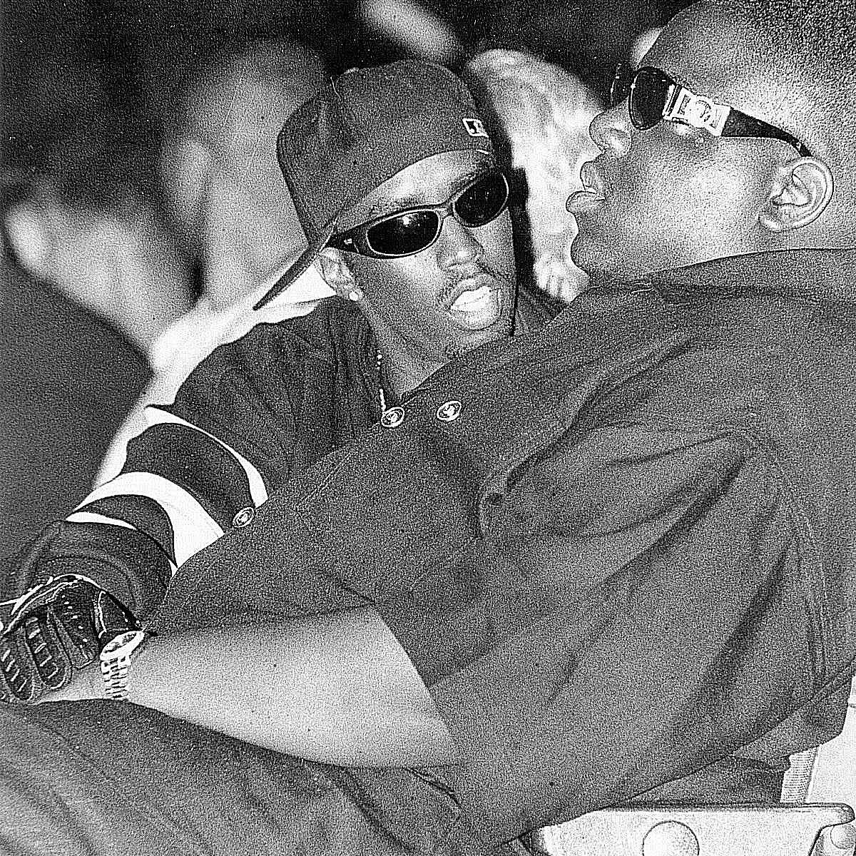 Candid photo of Puff Daddy and Biggie Smalls
