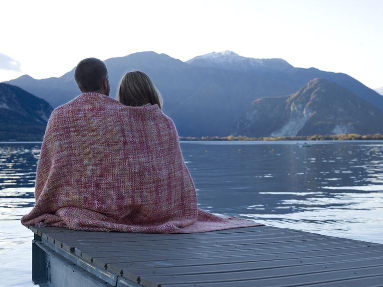 man and woman sitting on boat dock