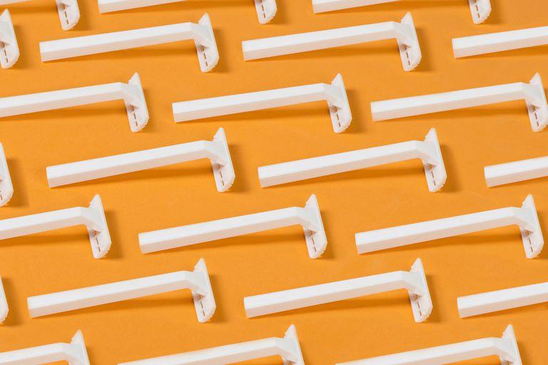 White razors on an orange background