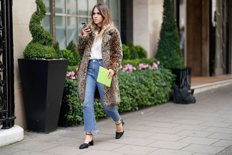 Woman wearing jeans and leopard print coat