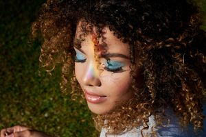 Young woman with natural hair wearing blue eyeshadow