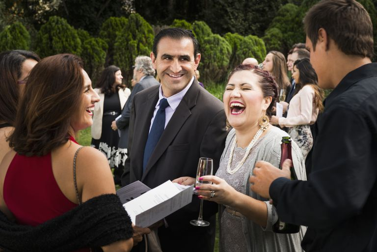 Hispanic family laughing during wedding