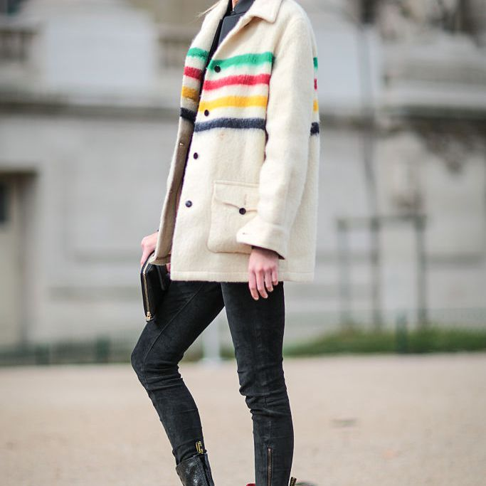Street style in a stripe Hudson Bay coat and black jeans