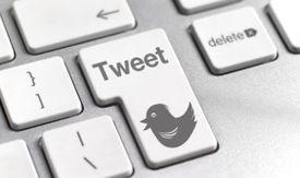 A Tweet key on a keyboard