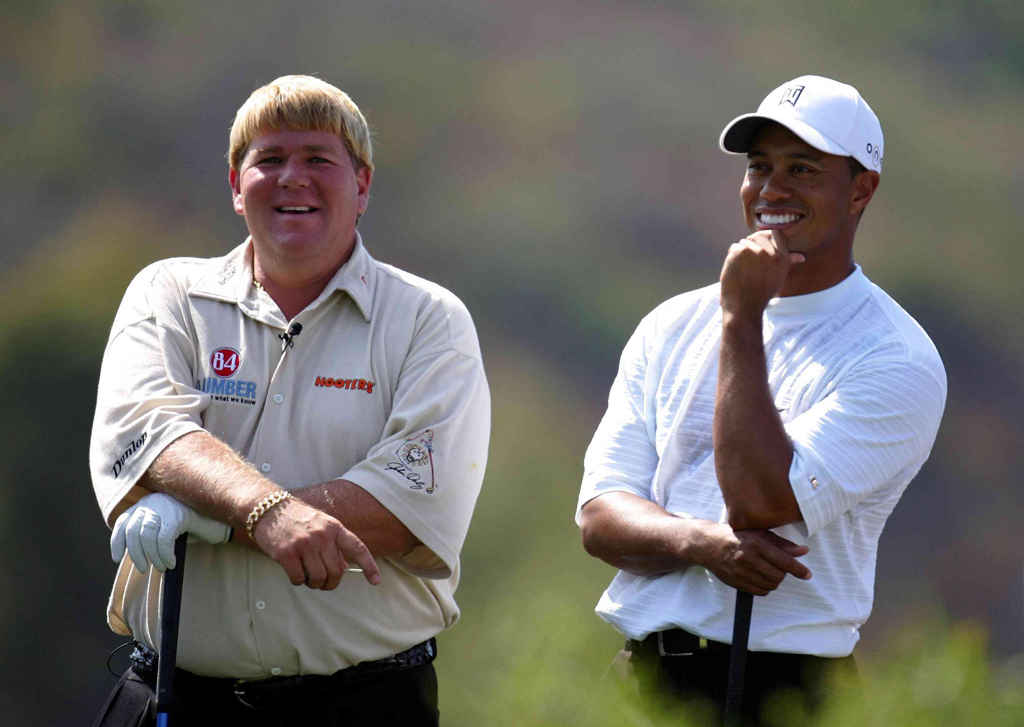 John Daly and teammate Tiger Woods joke on the 1st tee during the Battle at the Bridges on July 25, 2005 at The Bridges at Rancho Sante Fe in Rancho Sante Fe, California.