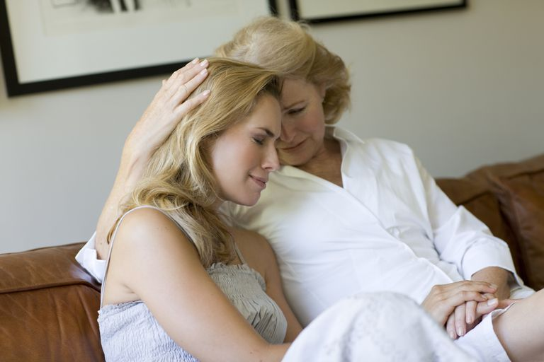 Mother comforting adult daughter going through divorce
