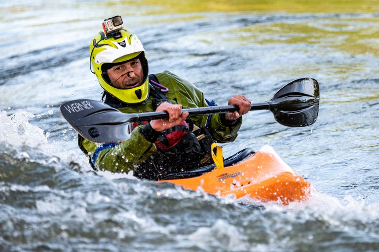 Close up of a man kayaking.