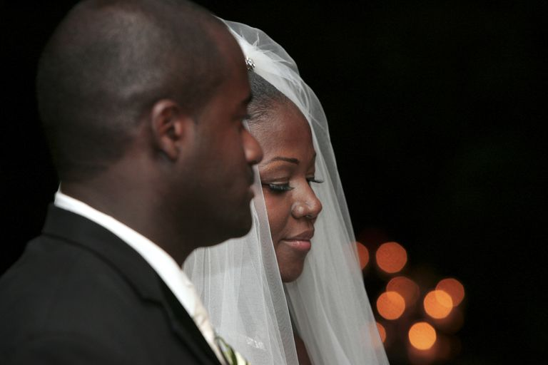 African American bride and groom at altar