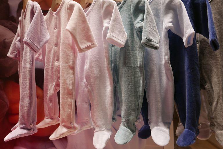 Baby onsies hanging up at a shop.