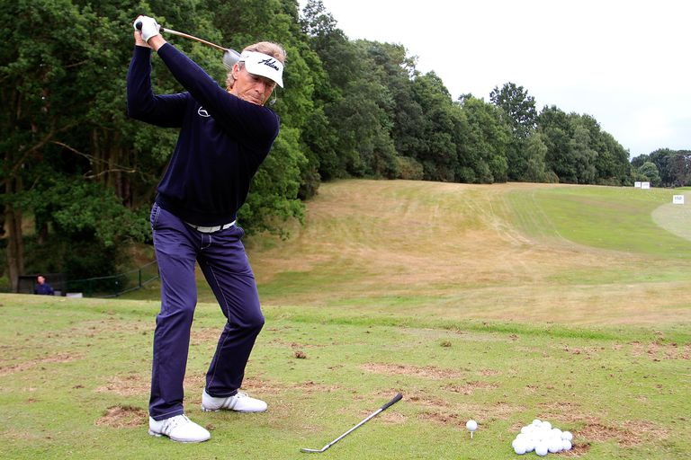 Bernhard Langer works on the golf practice range