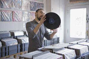 man reading record