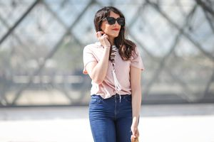 Woman wearing blue jeans and black sunglasses