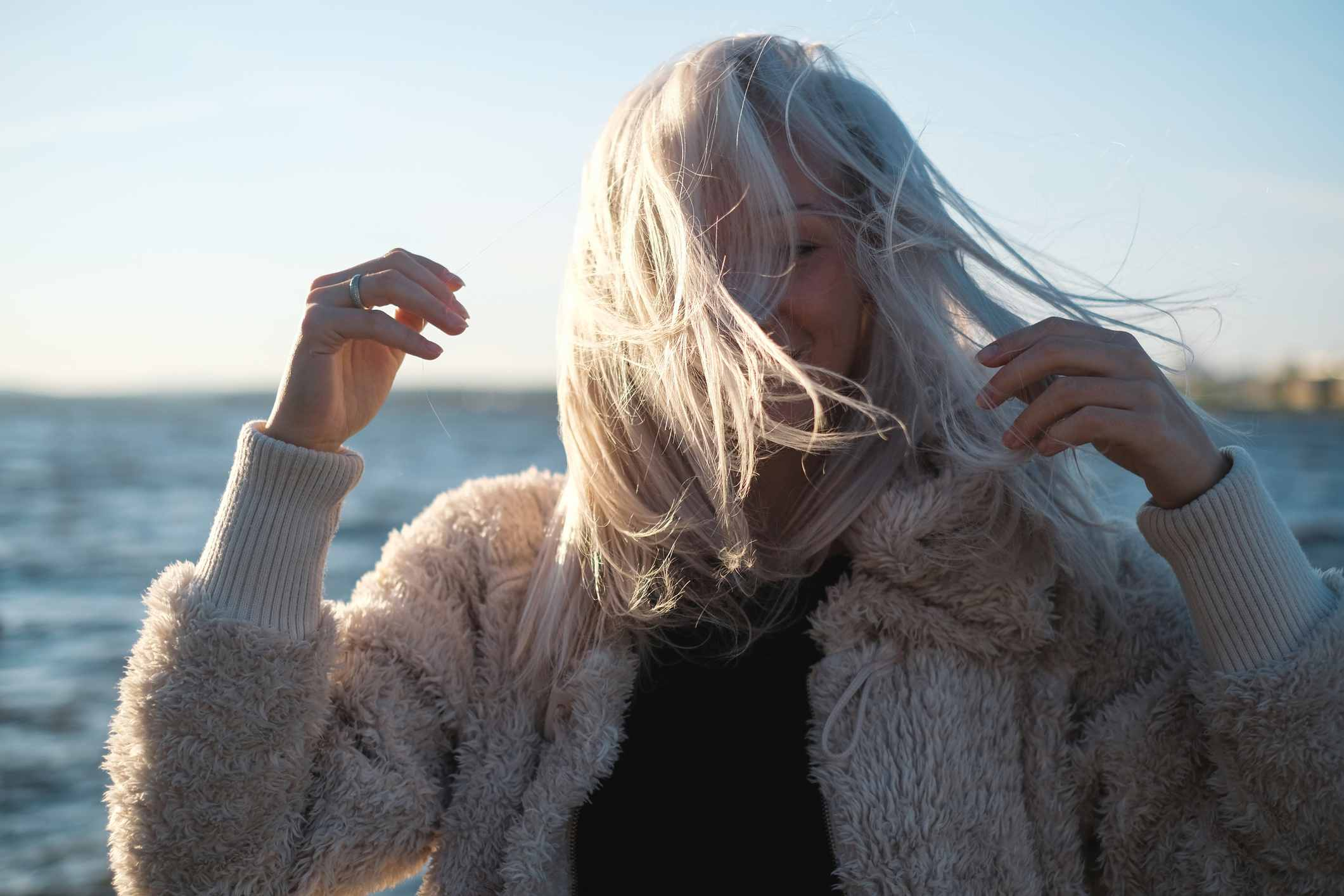 Woman with white hair bundled up