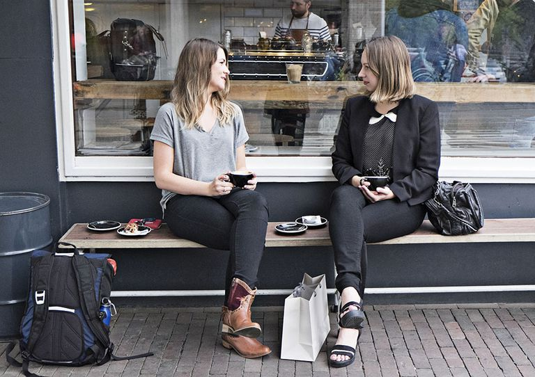 Women making small talk on bench