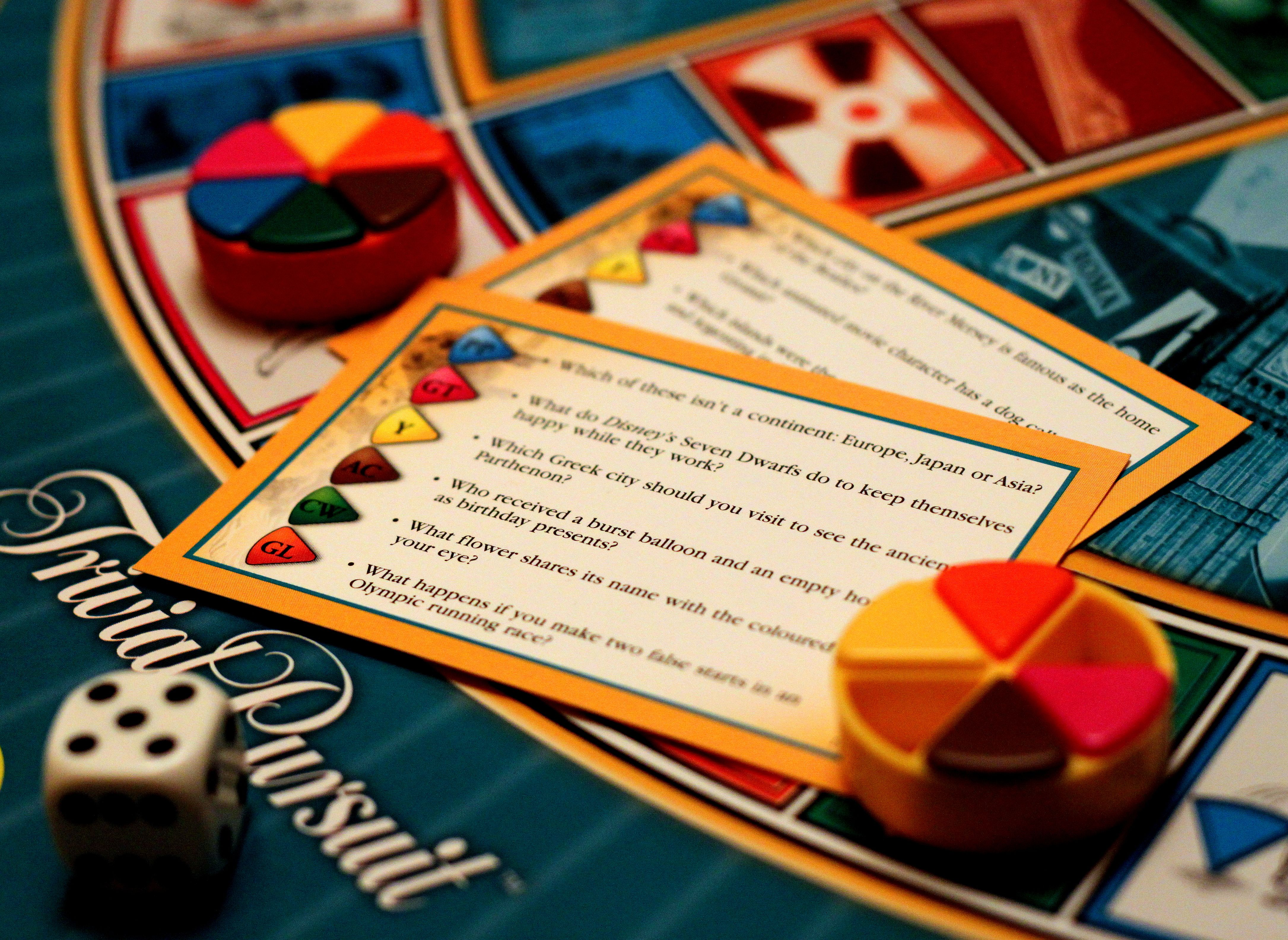 Game piece and cards from Trivial Pursuit