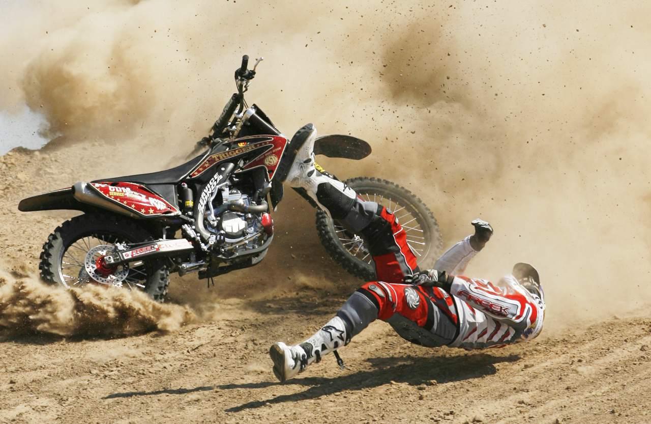A man falling off a dirtbike