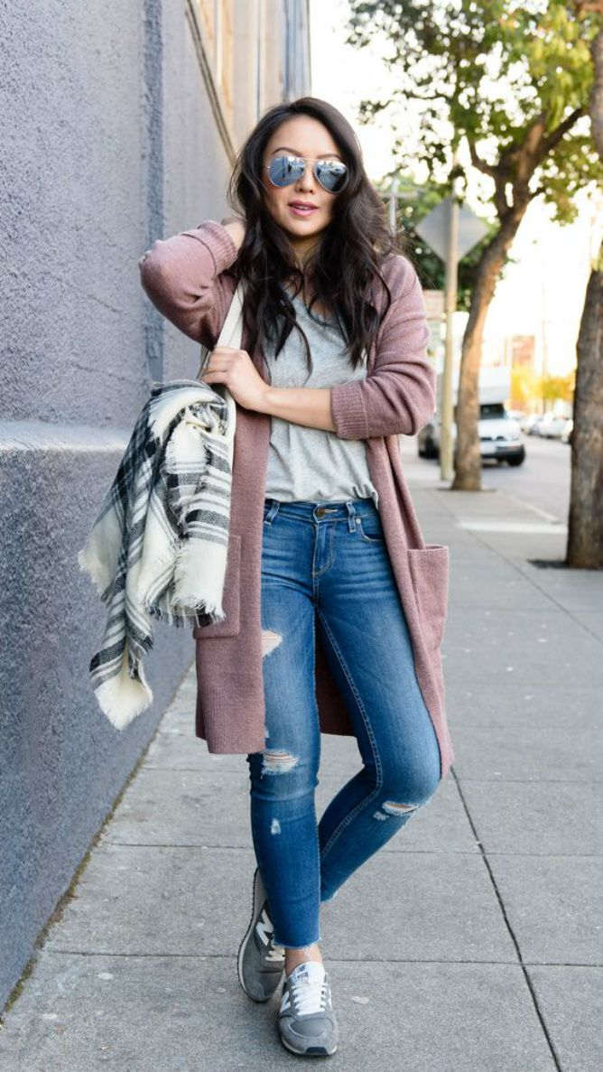 b5b99258787 Woman wearing jeans and long pink coat with a blanket scarf