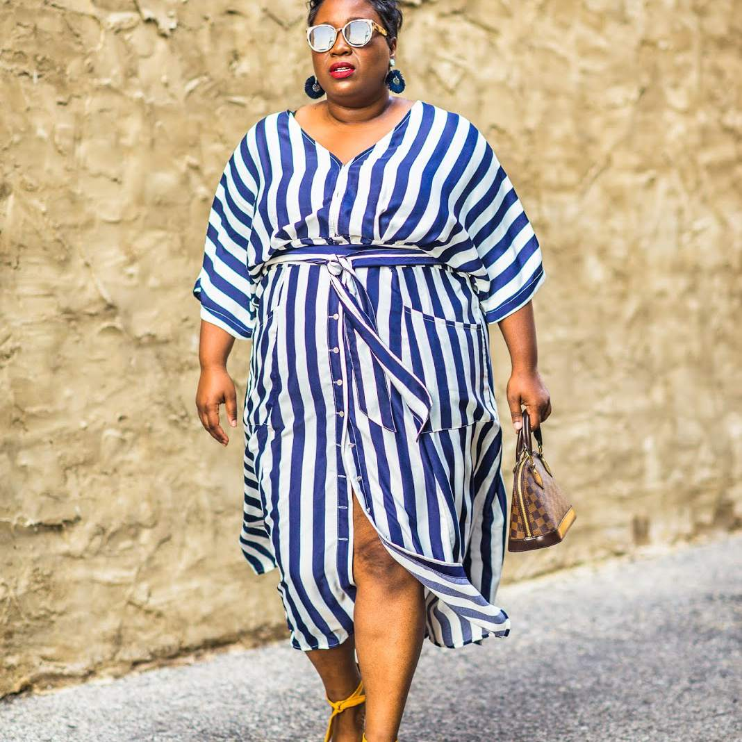 Woman in navy and white striped dress and yellow shoes