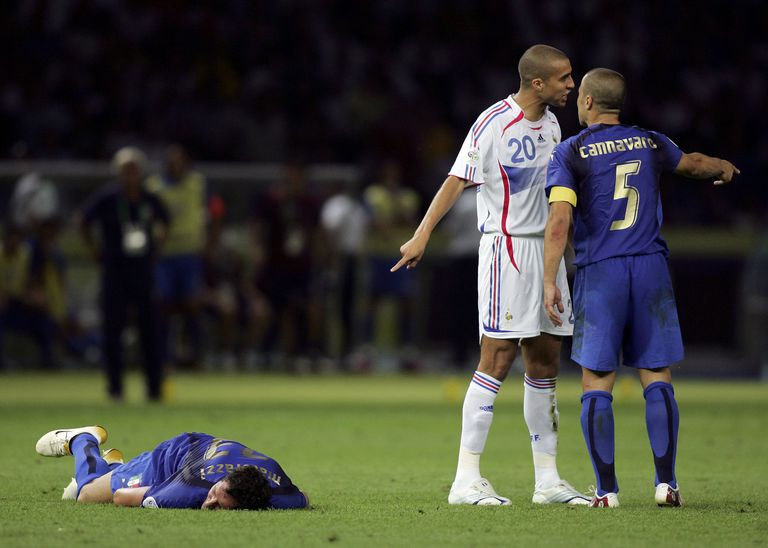 Marco Materazzi lies injured on the pitch, after being headbutted in the chest by Zinedine Zidane