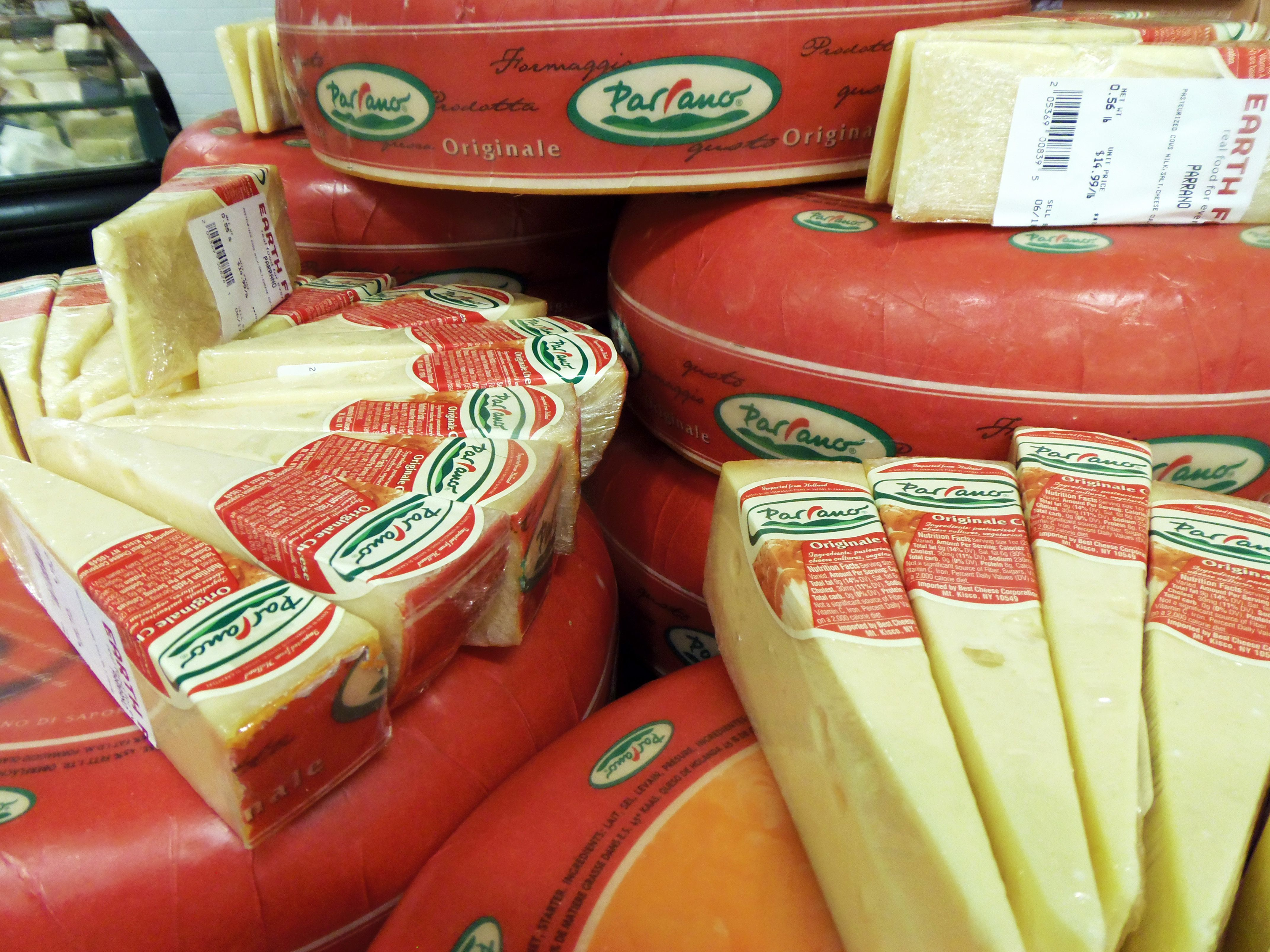 wheels and wedges of wrapped cheese