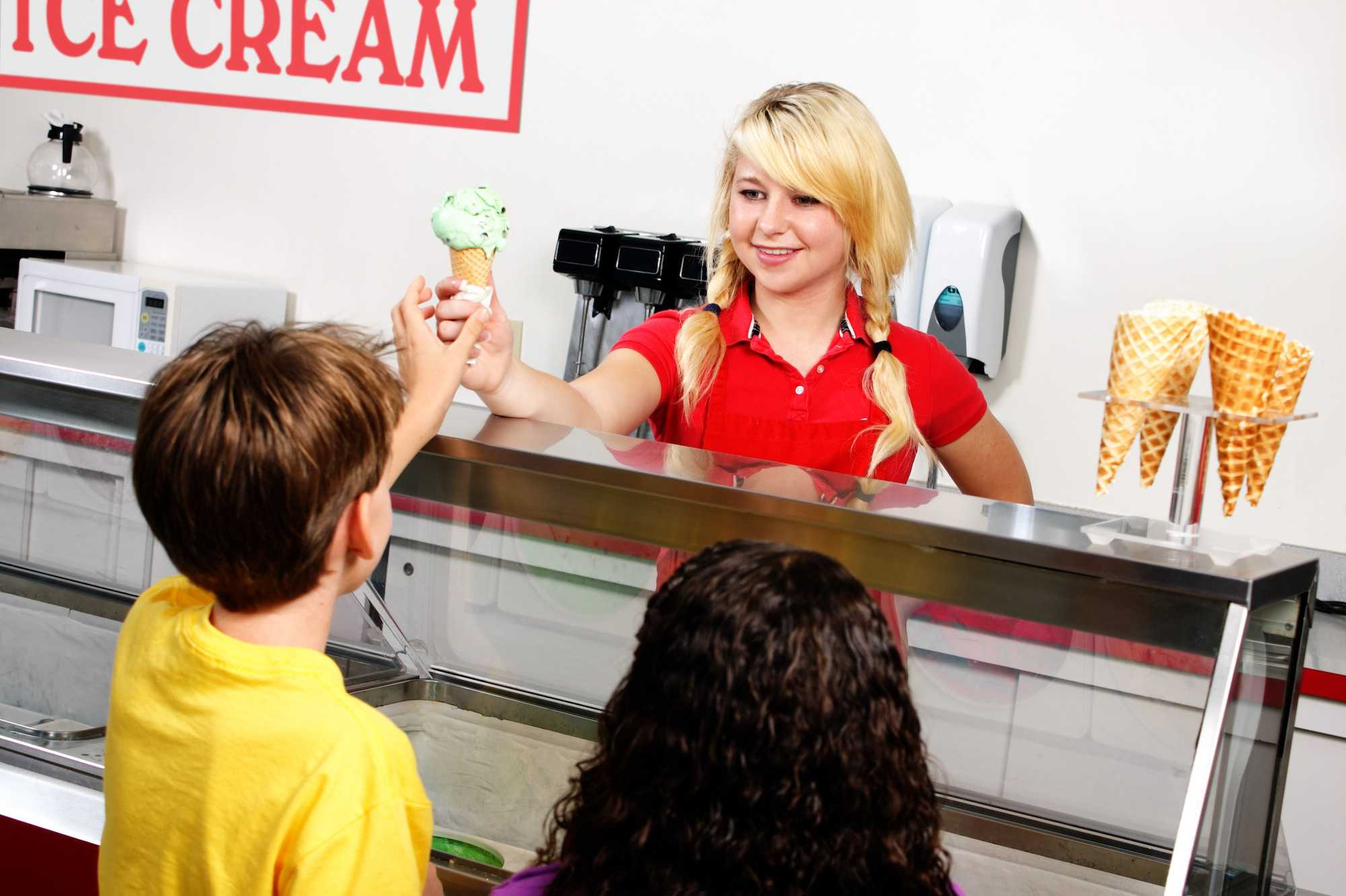 Young girl working in an ice cream shop