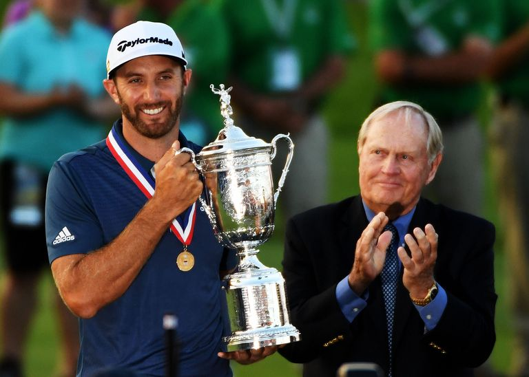 Dustin Johnson of the United States celebrates with the winner's trophy alongside Jack Nicklaus after winning the U.S. Open at Oakmont Country Club on June 19, 2016 in Oakmont, Pennsylvania