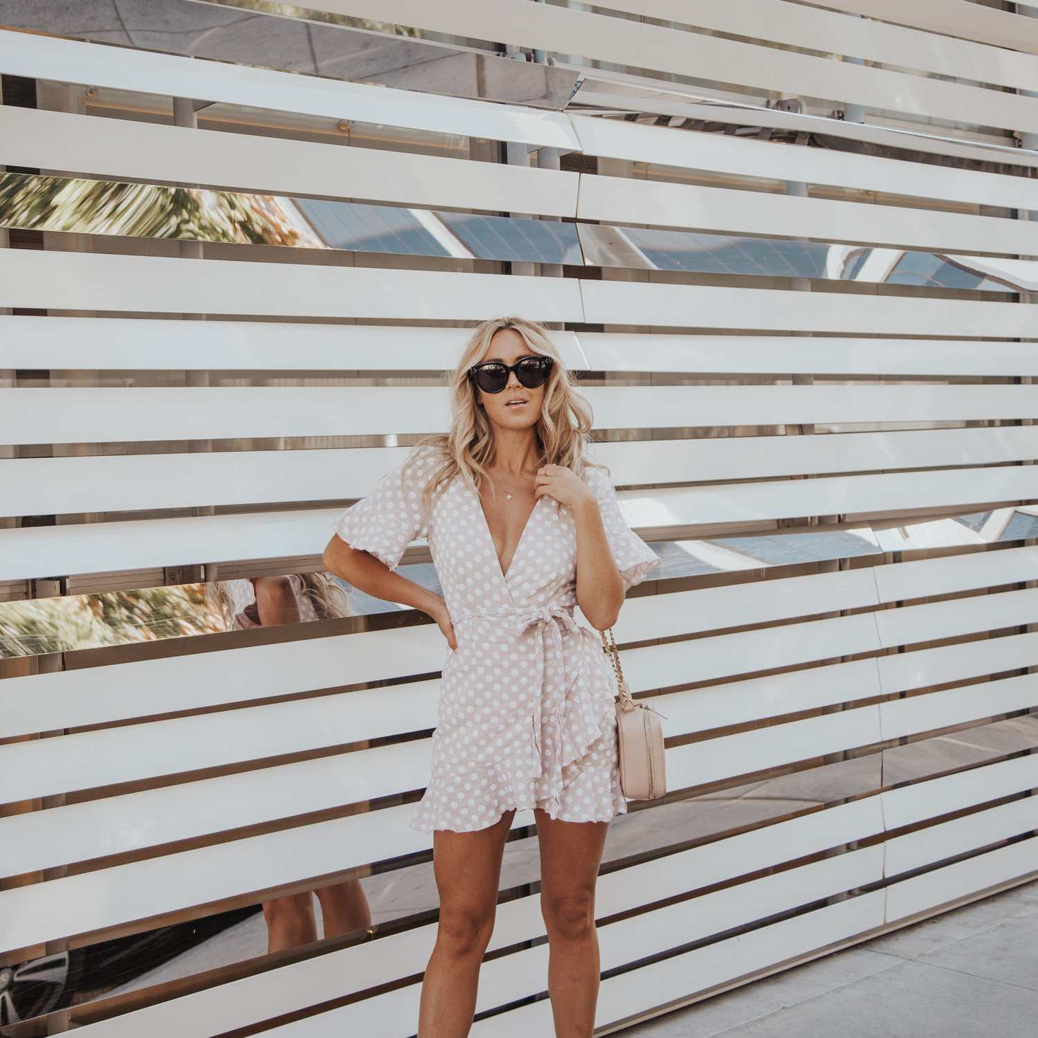 Woman in pink romper for summer street style