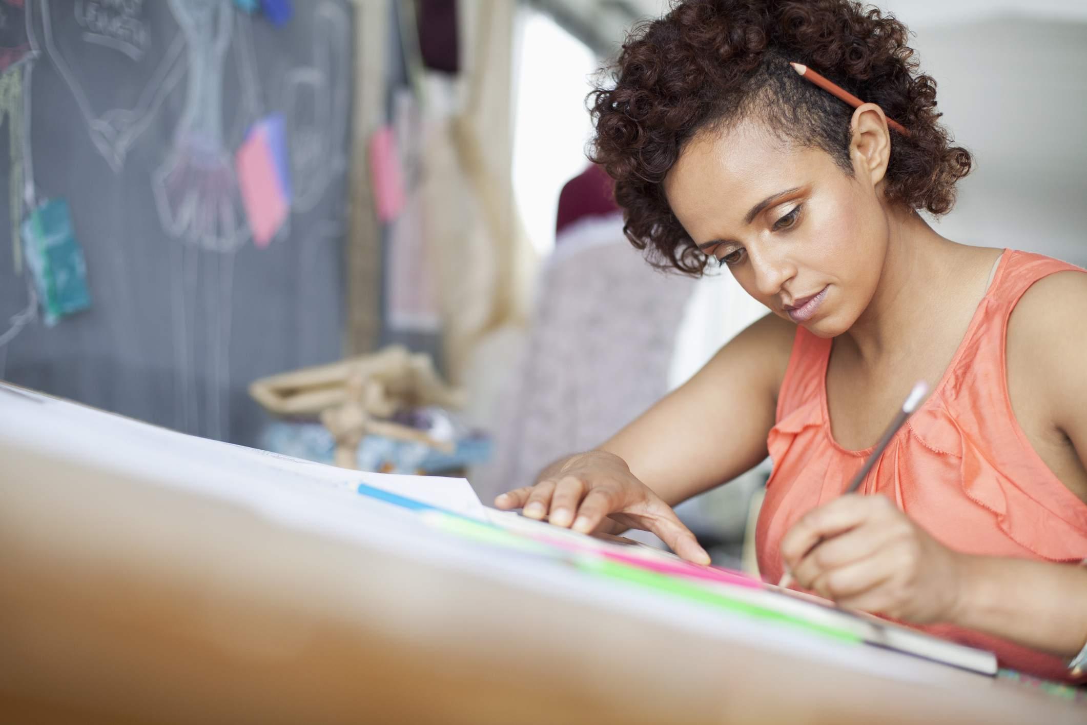 clothing designer sketching ideas in studio