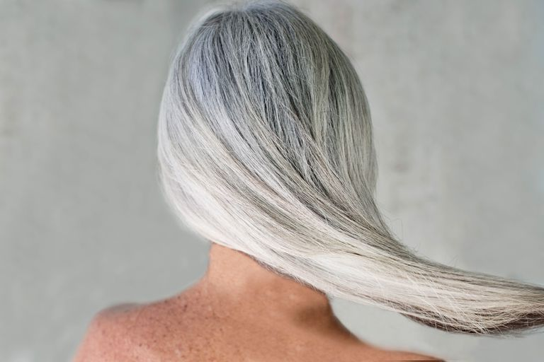 Rear view of bare shouldered mature woman with long grey hair b334eb16f273