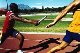 Relay runner passing baton