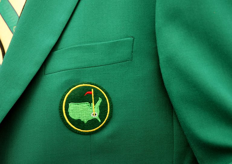 The Augusta National logo on the green jacket that signifies membership in the club.