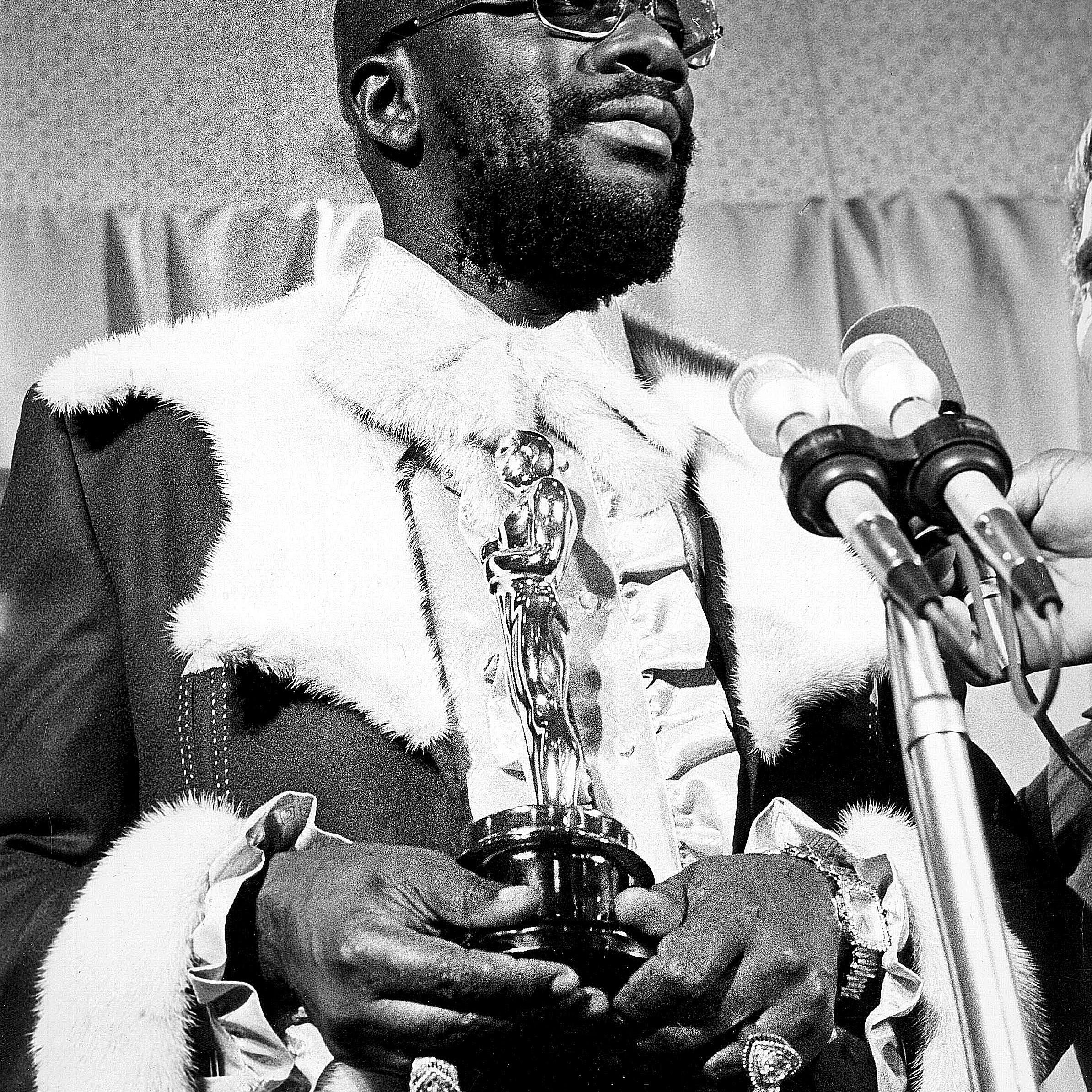Isaac Hayes holding his Oscar for Best Original Song