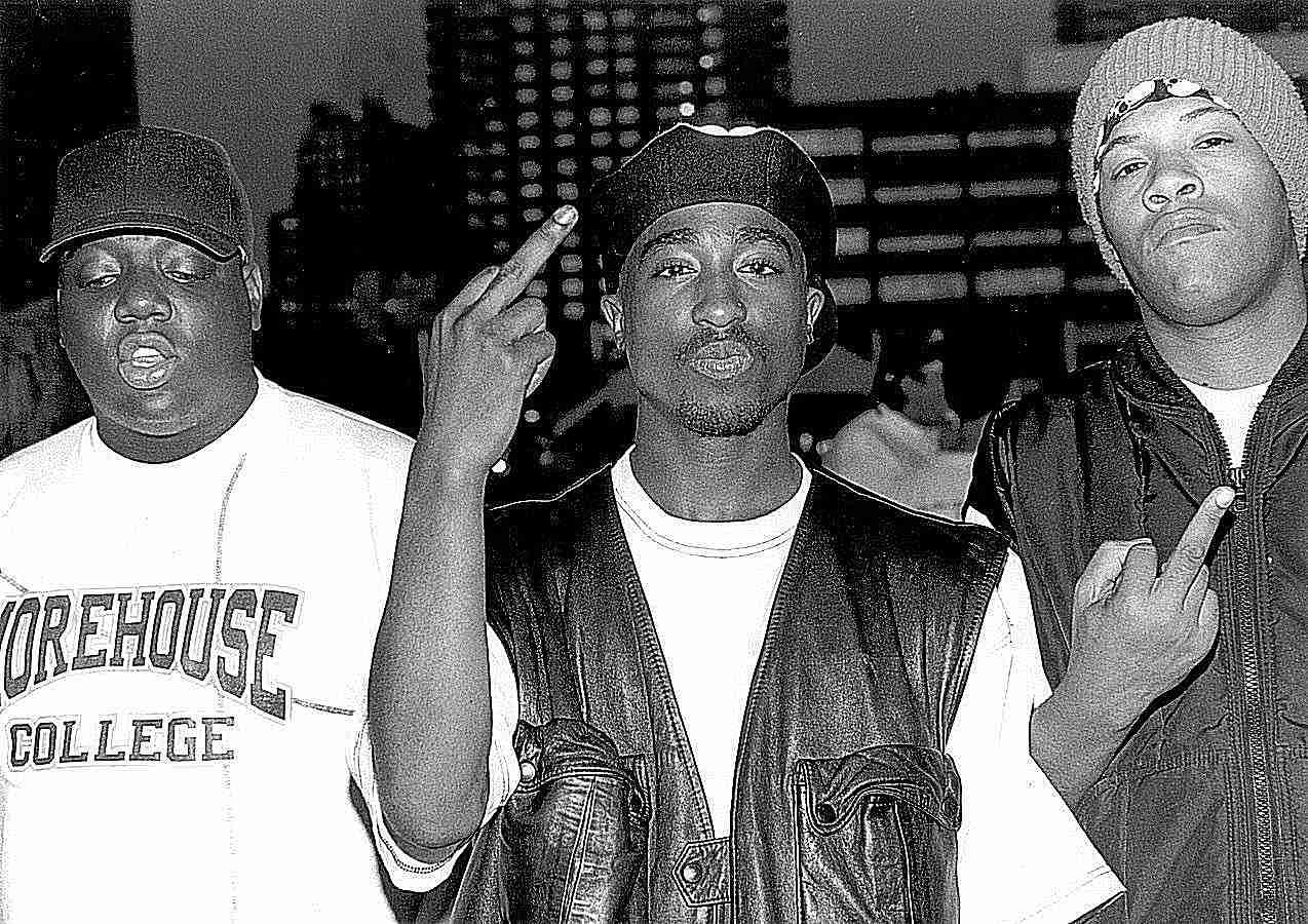 A candid photo of Biggie Smalls, Tupac Shakur, and Redman