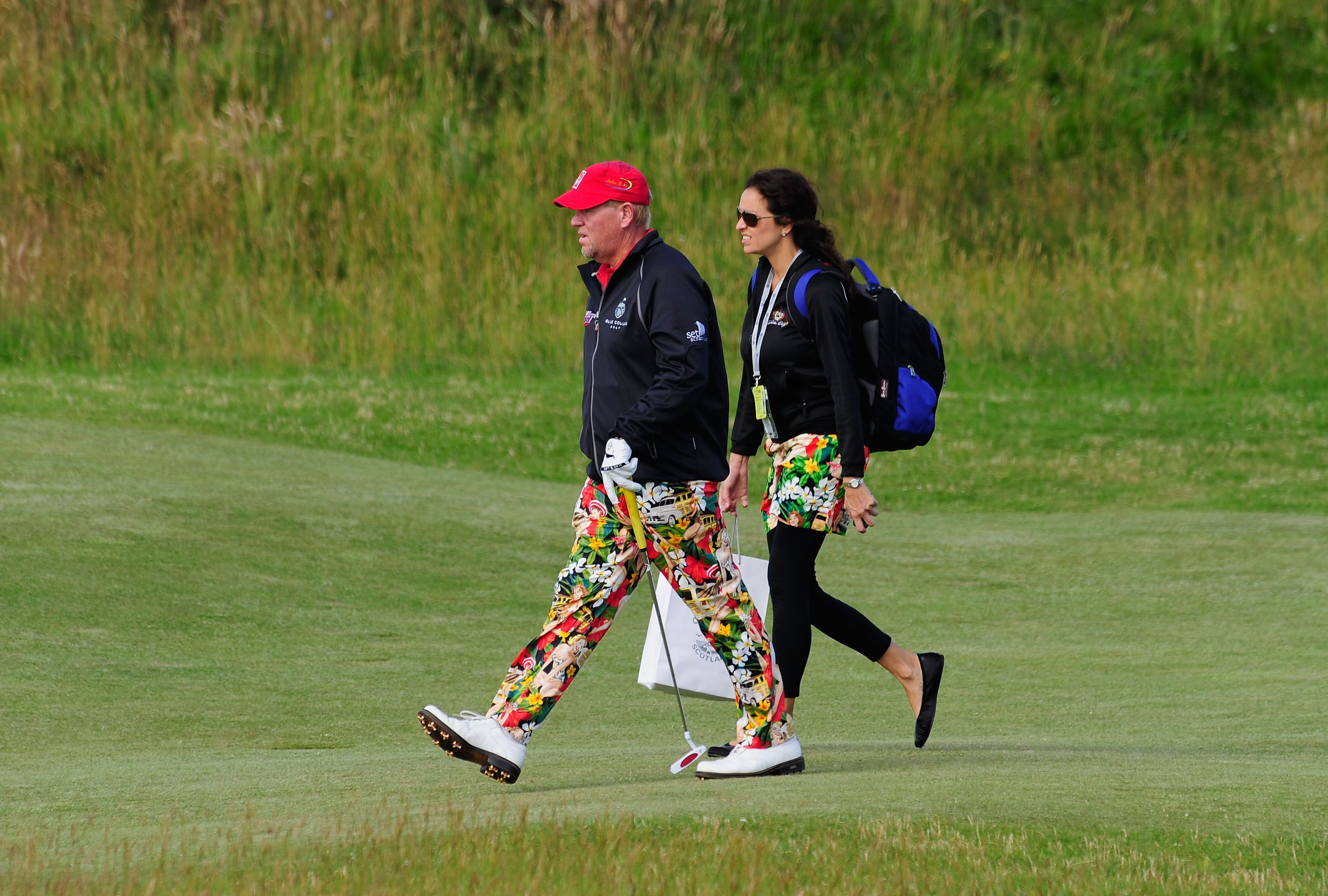 Daly in Loudmouth trousers and with his then-girlfriend Anna Cladakis at the 2010 Open Championship.