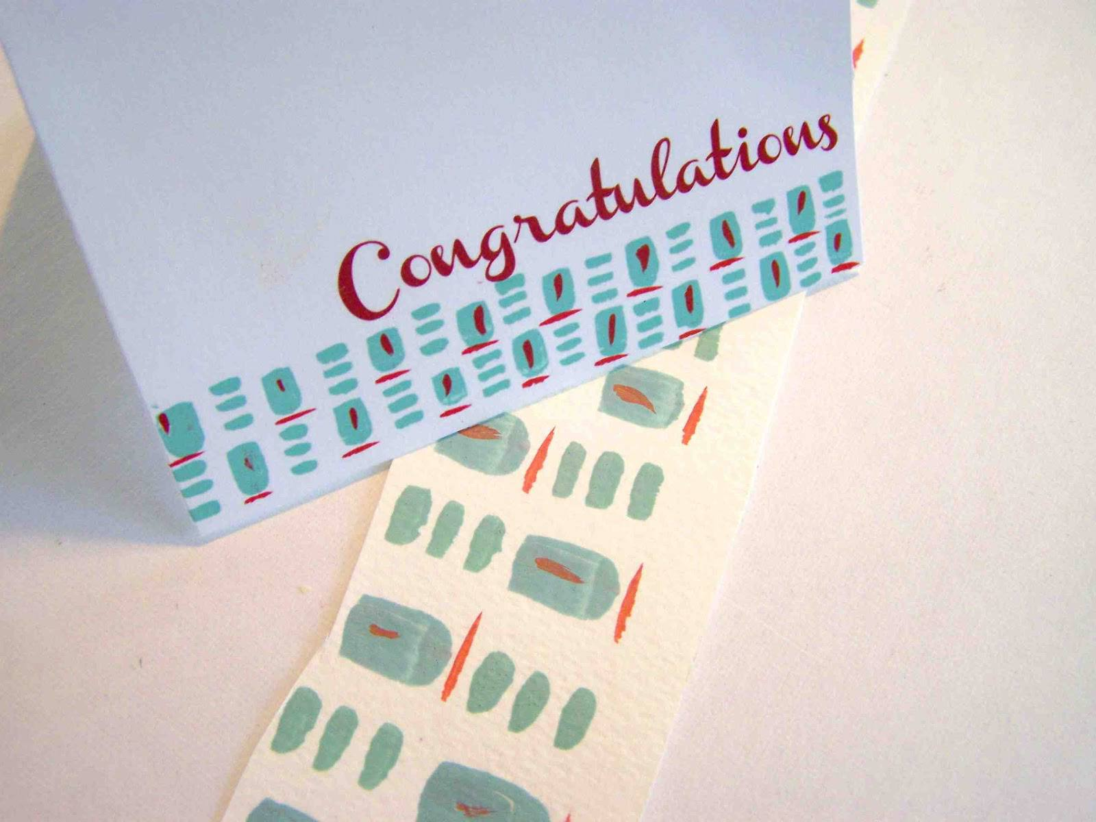 A red and teal congratulations wedding card