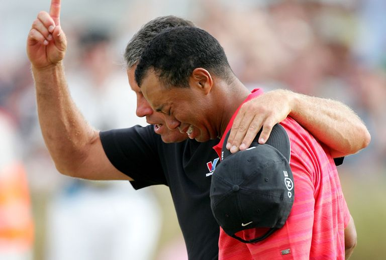 Tiger Woods of USA walks off the 18th green in tears with his caddy Steve Williams after his 2006 British Open win