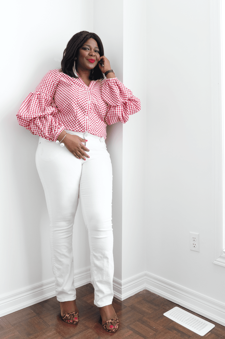 Woman in gingham blouse and white jeans