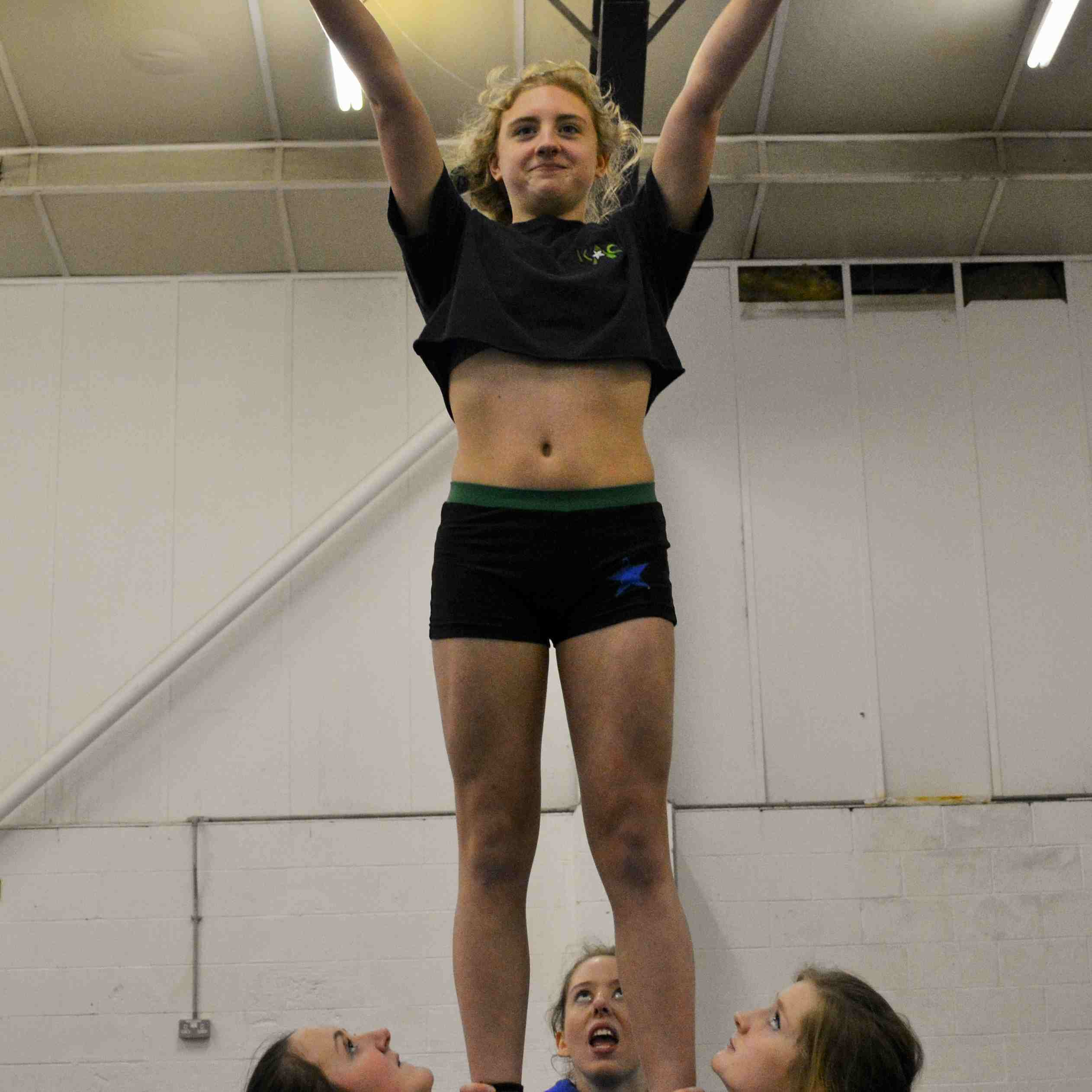 cheerleaders preparing for the move