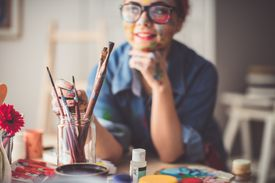 woman with paint brushes