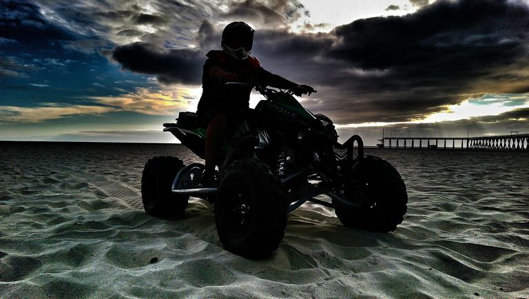 Silhouette Of Man On Quad Bike
