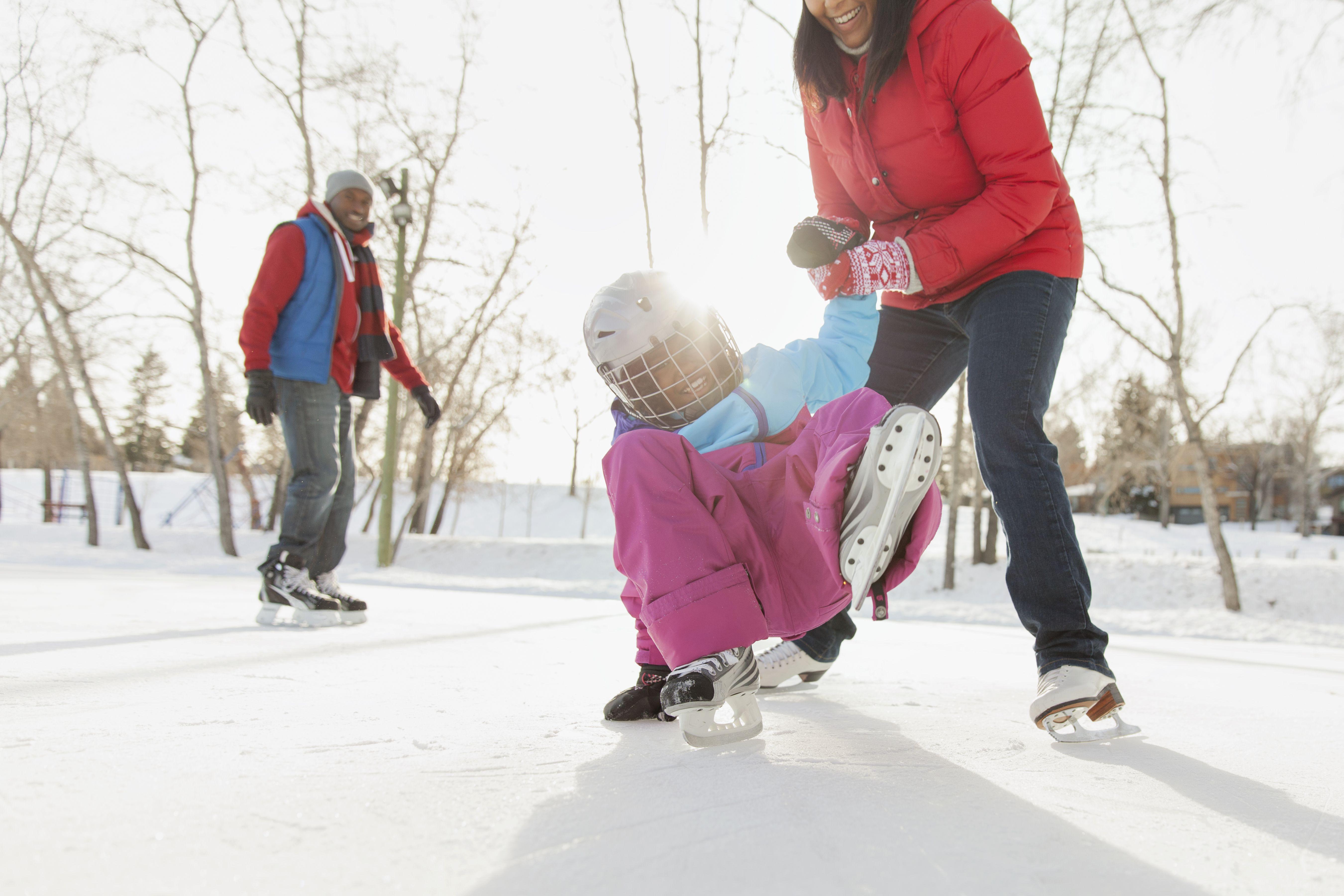 Family ice-skating outdoors