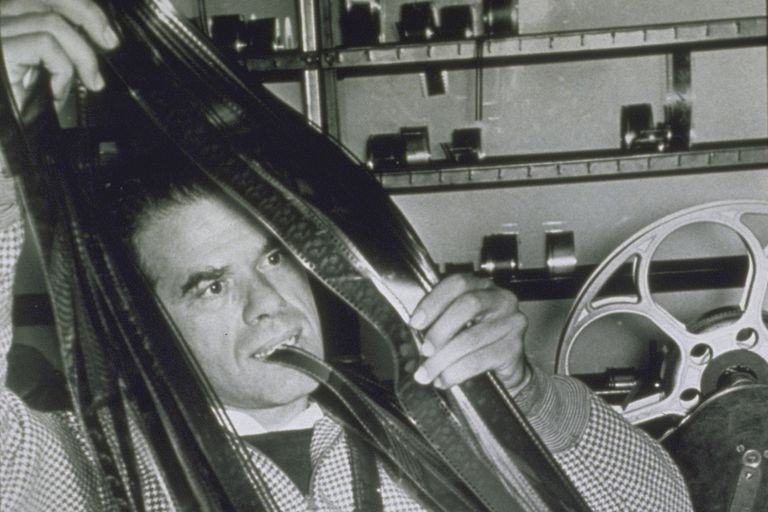 Filmmaker Frank Capra editing film
