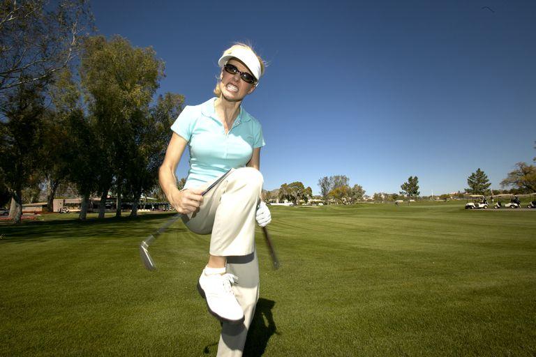 Female golfer breaks club over her knee
