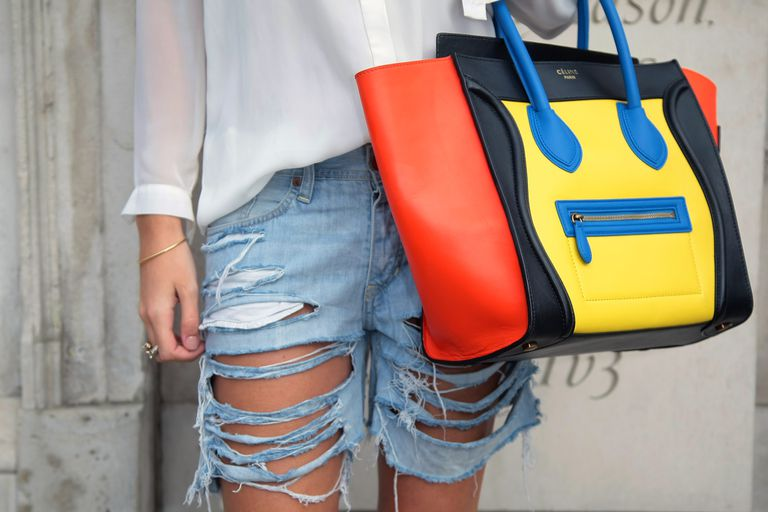 Distressed jean shorts and designer purse