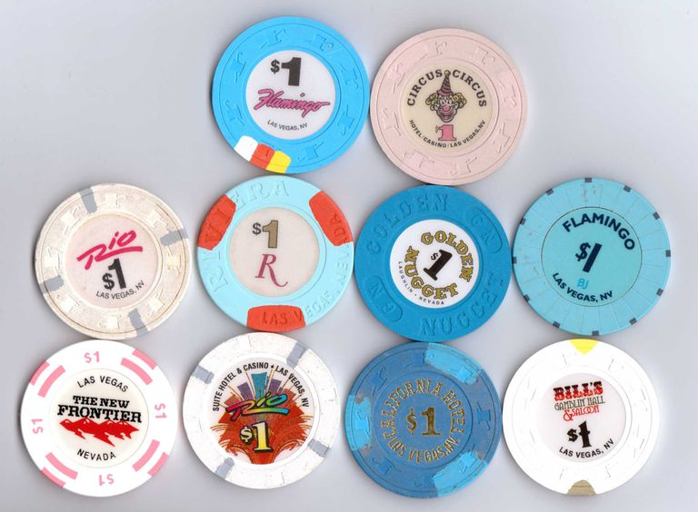 Ten different kinds of casino chips.